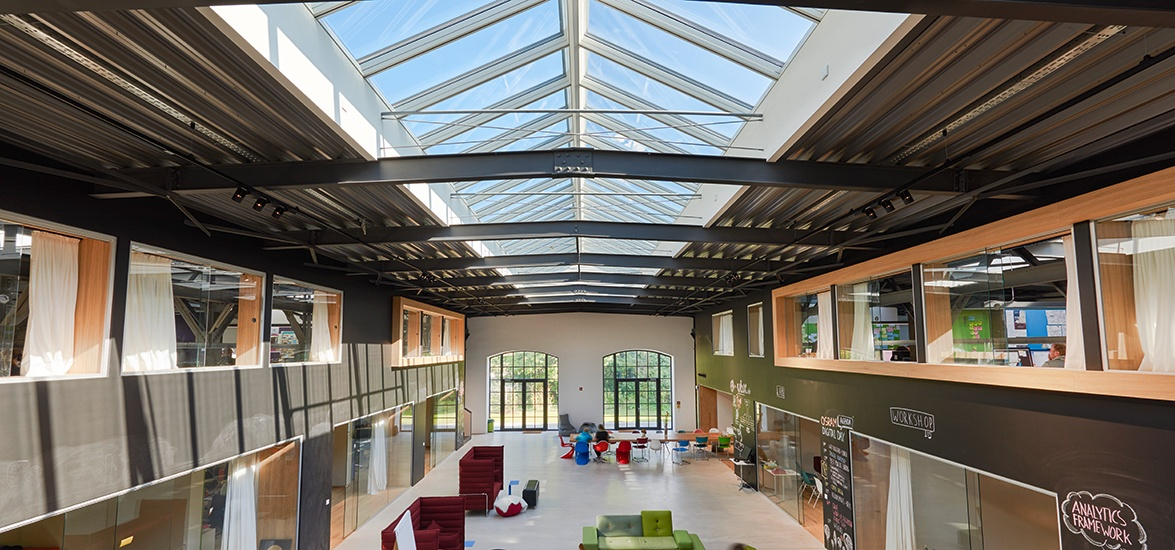 School hall illuminated with natural light through roof skylights